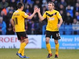 Fleetwood Town's Alan Goodall high fives Barry Nicholson after scoring his team's second goal on December 15, 2012