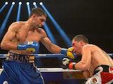 Amir Khan lands a punch at Carlos Molina on December 15, 2012
