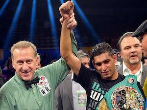 Khan tips Mayweather to beat Alvarez