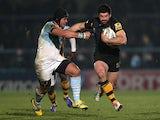 London Wasps' Andrea Masi hands off Bayonne's Manu Ahota'e'iloa on December 13, 2012