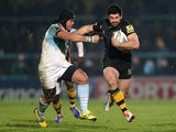 London Wasps' Andrea Masi hands off Bayonne's Manu Ahota'e'iloa on December 13, 2012