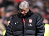 Arsenal boss Arsene Wenger looks dejected at half-time against Bradford on December 11, 2012