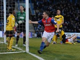 Gillingham's Charlie Lee celebrates scoring his team's first goal on December 15, 2012