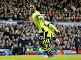 Christian Benteke celebrates his opener at Anfield on December 15, 2012