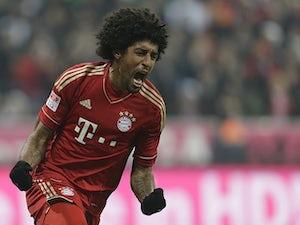 Bayern defender Dante rues a miss against Borussia Moenchengladbach on December 14, 2012