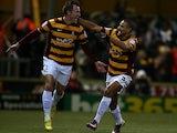 Bradford's Garry Thompson celebrates his goal against Arsenal on December 11, 2012