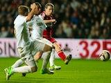 Middlesbrough's Grant Leadbitter has a shot on goal against Swansea City on December 12, 2012