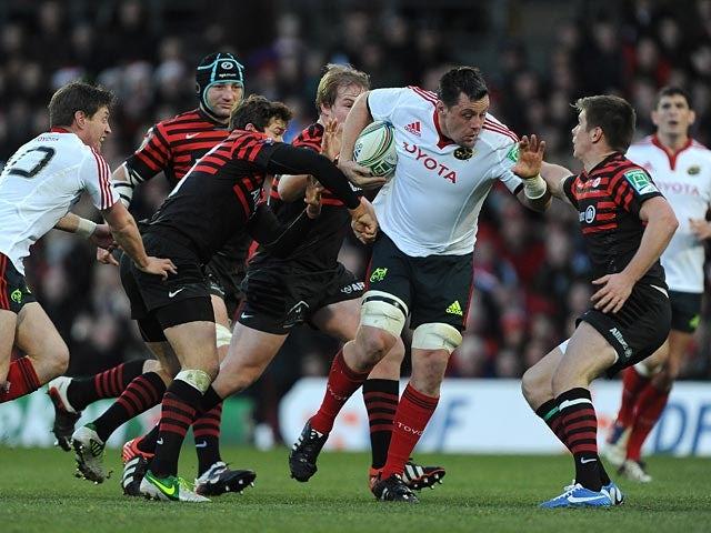 Munster's James Coughlan battles through the Saracens' defence on December 16, 2012