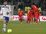 Nancy players mob Jordan Loties after his goal versus Lyon on December 12, 2012