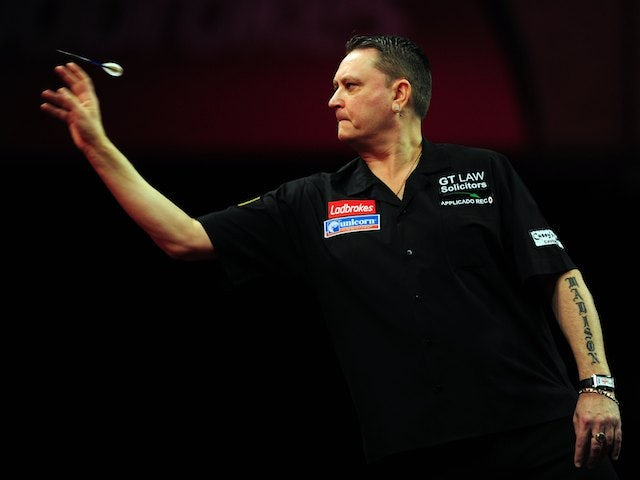 Kevin Painter in action at the World Darts Championship on December 14, 2012