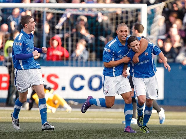 Montrose's Lloyd Young is congratulated by team mates after scoring the opener against Rangers on December 15, 2012