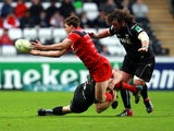 Toulouse's Luke Burgess is tackled by an Osprey player on December 15, 2012