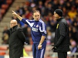 Martin O'Neill lectures the fourth official as Brian McDermott watches the action on December 11, 2012