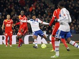 Lyon's Michel Bastos takes a shot against Nancy during their 1-1 on December 12, 2012