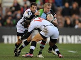 Harlequins' Mike Brown is tackled by Zebra's Samuele Pace and Giovanbattista Venditti on December 15, 2012
