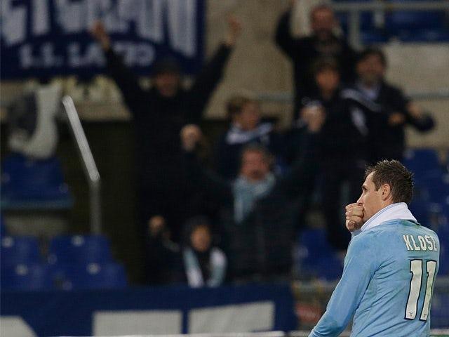 Lazio's Miroslav Klose celebrates after scoring against Inter Milan on December 15, 2012