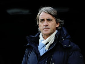 Mancini spotted on tube to Emirates