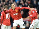United striker Robin Van Persie celebrates his opener against Sunderland on December 15, 2012