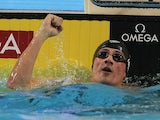 Ryan Lochte punches the air after breaking the another world record on December 15, 2012