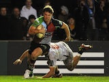 Harlequins Sam Smith runs on to score a try against Zebre on December 15, 2012