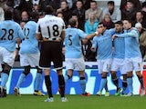 City players congratulate Sergio Aguero on his early goal versus Newcastle on December 15, 2012