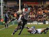Harlequins Ugo Monye gets past Zebra's Giovanbattista Venditti on December 15, 2012