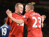 Tom Cleverley congratulates Wayne Rooney after his goal on December 15, 2012