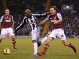 West Brom's Youssuf Mulumbu battles with Mark Noble on December 16, 2012