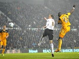Hull's Abdoulaye Faye jumps to score their winning goal against Derby on December 21, 2012