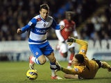 Reading forward Adam Le Fondre pulls one back against Arsenal on December 17, 2012