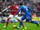 Arsenal's Alex Oxlade-Chamberlain and Wigan Athletic's Jean Beausejour on December 22, 2012