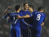 Chelsea's Fernando Torres is congratulated by team mates after scoring his team's fifth goal against Leeds on December 19, 2012