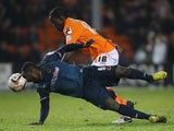 Blackpool's Isaiah Osbourne challenges Wolves' Sylvain Ebanks-Blake for the ball on December 21, 2012