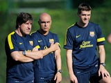 Barca coach Jordi Roura (left) with a club physio and manager Tito Villanova at training on July 17, 2012