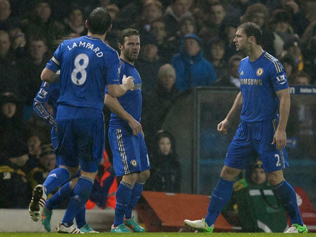 Chelsea's Juan Mata is congratulated by team mates after scoring the equaliser against Leeds on December 19, 2012
