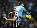 Mike Williamson and Adel Taarabt in action on December 22, 2012