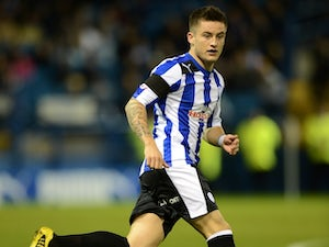 Sheffield Wednesday's Rhys McCabe in action against Huddersfield in November 2011