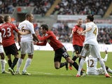 United's Van Persie reacts angrily to a challenge by Ashley Williams of Swansea on December 23, 2012