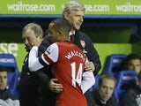 Gunners boss Arsene Wenger hugs goalscorer Theo Walcott as he comes off at Reading on December 17, 2012