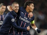 PSG defender Thiago Silva is congratulated by Jeremy Menez after a goal on December 4, 2012