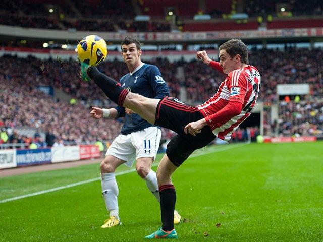 Adam Johnson beats Gareth Bale to the ball on December 29, 2012