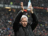 Newcastle boss Alan Pardew applauds the travelling Magpies fans at Old Trafford on December 26, 2012