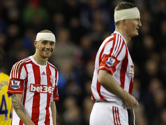 Stoke City defenders Andy Wilkinson and Robert Huth with bandaged heads after clashing heads during the match on December 29, 2012