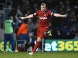 West Brom's Chris Brunt celebrates his opening goal against QPR on December 26, 2012