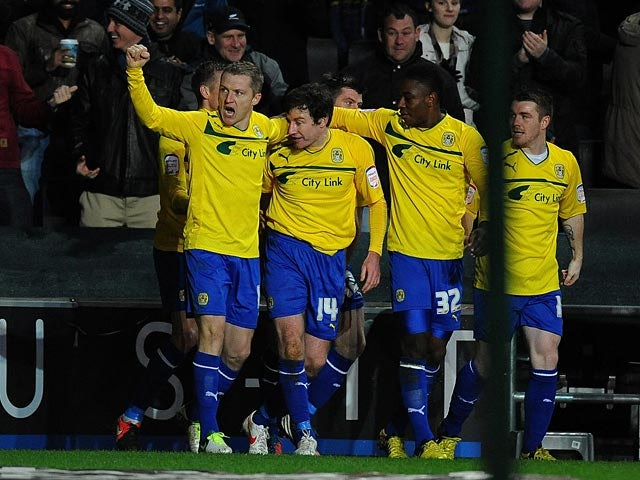 Stephen Elliott is congratulated by team mates after scoring his first goal on December 29, 2012