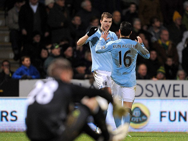 Sergio Aguero and Edin Dzeko celebrate their team's fourth goal against Norwich City on December 29, 2012