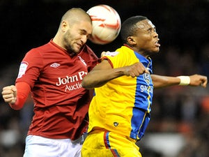 Nottingham Forest's Henri Lansbury and Crystal Palace's Kagisho Dikgacoi battle for the ball on December 29, 2012