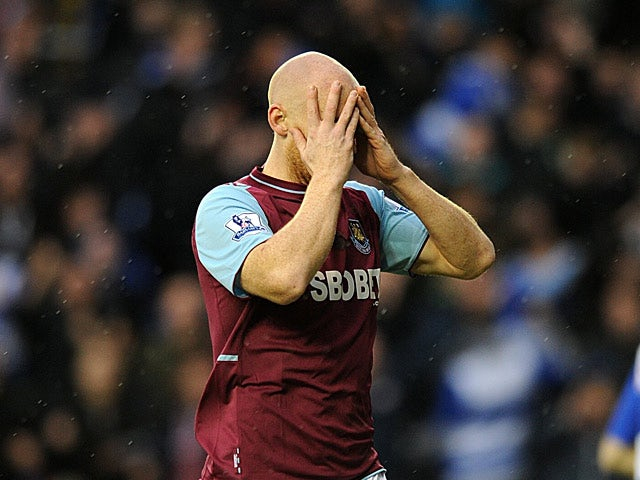 James Collins holds his head in his hands after gifting the ball to Pavel Pogrebnyak to score the opener on December 29, 2012