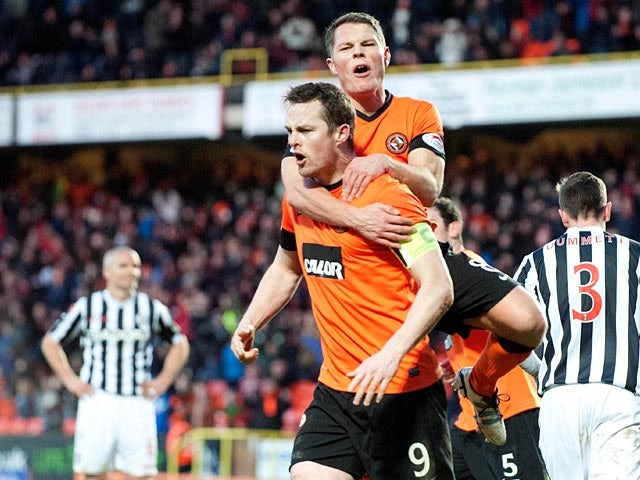 Dundee United's John Rankin congratulates Jon Daly after scoring a penalty against St Mirren on December 30, 2012