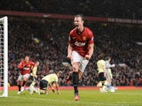 Man Utd defender Jonny Evans celebrates his equaliser against Newcastle on December 26, 2012